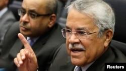 FILE - Saudi Arabian Oil Minister Ali al-Naimi talks to journalists before a meeting of OPEC oil ministers at OPEC's headquarters in Vienna, Nov. 27, 2014.
