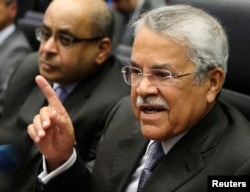 FILE - Saudi Arabian Oil Minister Ali al-Naimi talks to journalists before a meeting of OPEC oil ministers at OPEC's headquarters in Vienna, Nov. 27, 2014.