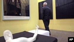 "A man walks past the sculpture titled ""Marble Arm"" by Chinese dissident artist Ai Weiwei at Hong Kong International Art Fair, May 25, 2011"