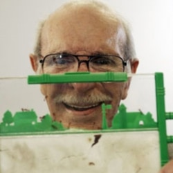 Milton Levine, co-inventor of the classic Ant Farm educational toy, poses with his invention in 2006