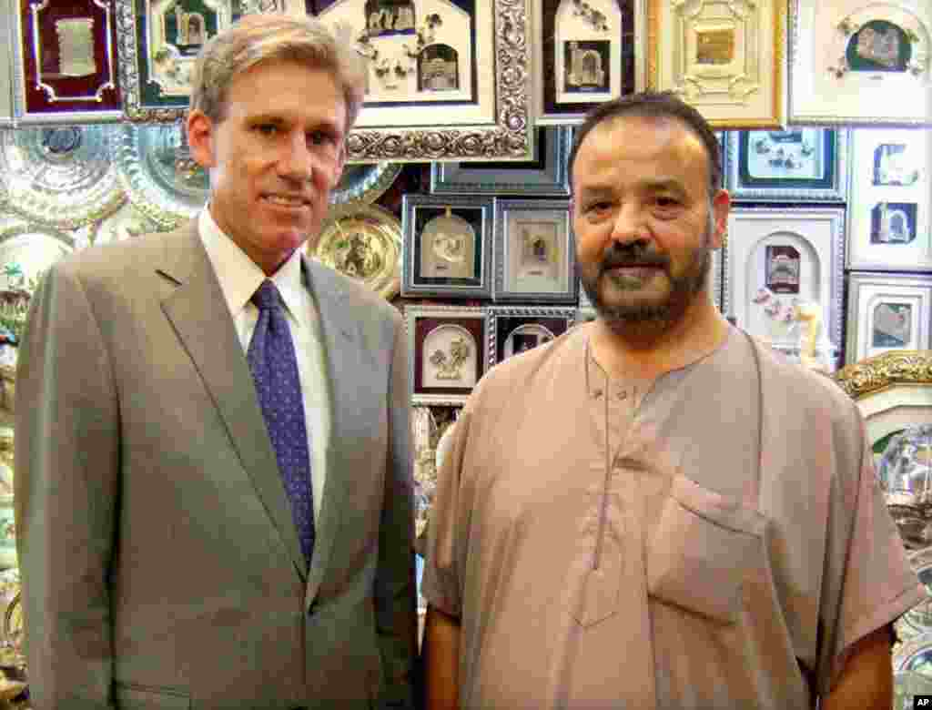 In this photo posted on the U.S. Embassy Tripoli Facebook page, Christopher Stevens poses with a shop owner in Tripoli, Libya, August 12, 2012.