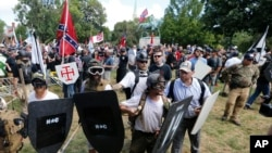 """""""Alt-right"""" demonstrators clash with counter-demonstrators at the entrance to Lee Park in Charlottesville, Va., Aug. 12, 2017."""