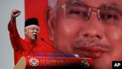 FILE - Malaysian Prime Minister Najib Razak addresses delegates during his speech at the Malaysia's ruling party United Malays National Organization's (UMNO) anniversary celebration.