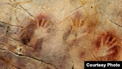 Hand prints dating from 37,000 years ago, and a red disk from 40,600 years ago (not pictured), in El Castillo Cave in Spain, are the oldest cave paintings in Europe. (Pedro Saura)