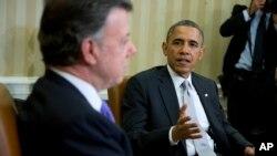 En la imagen, el presidente Obama junto a Juan Manuel Santos en la última visita de éste a EE.UU. en 2013.