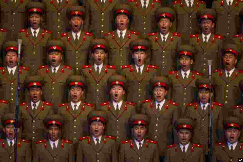 A North Korean choir sings during a concert in Pyongyang on Monday April 16, 2012 to commemorate 100 years since the birth of Kim Il Sung. (AP Photo/David Guttenfelder)
