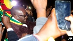 Pastor Evan Mawarire leaves the Harare Magistrates Court, Zimbabwe, July 13, 2016, after the court freed him ruling that police violated his rights.