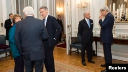 Officials involved in Iran nuclear talks are seen meeting for dinner at the residence of the British ambassador in Vienna November 23, 2014. U.S. Secretary of State John Kerry is at right.