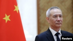 FILE - Chinese Vice Premier Liu He attends the EU-China High-level Economic Dialogue at Diaoyutai State Guesthouse in Beijing, China, June 25, 2018. He is to meet his U.S. counterparts in Washington next week.