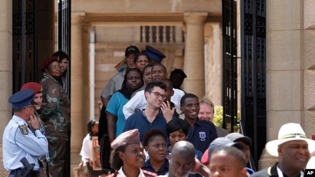 Members of the public make their way through the Union Buildings to pay their respects to former South African President Nelson Mandela during his lying in state in Pretoria, South Africa, Wednesday, Dec. 11, 2013.