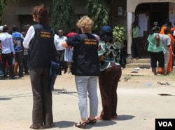 EU observers at a polling station in Dar es Salaam, Tanzania, Sunday, Oct. 25, 2015.