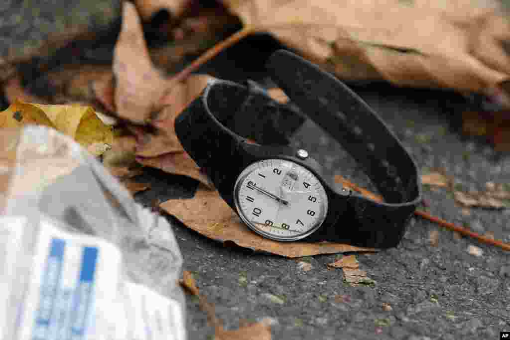A watch lays on the ground outside the Bataclan concert hall, Nov. 14, 2015 in Paris.