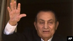 Ousted former Egyptian President Hosni Mubarak waves to his supporters from his room at the Maadi Military Hospital, where he is hospitalized, as they celebrate Sinai Liberation Day that marks the final withdrawal of all Israeli military forces from…
