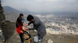 FILE - A boy receives polio vaccination drops during an anti-polio campaign in Kabul, Afghanistan.