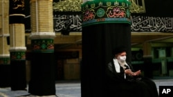 In this picture released by the office of the Iranian supreme leader shows Supreme Leader Ayatollah Ali Khamenei wearing a protective face mask to help prevent spread of the coronavirus as he listens to a reciting of the Quran, Islam's holy book,…