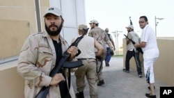 Libyan rebels patrol to try to find any of Moammar Gadhafi's relatives in Tripoli, Libya, August 24, 2011