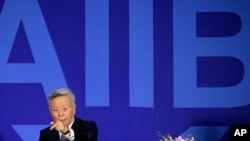 FILE - Jin Liqun, inaugural president of the Asian Infrastructure Investment Bank (AIIB), gestures as he speaks during a press conference at a hotel in Beijing, Jan. 17, 2016.