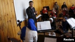 FILE - Ahmad Naser Sarmast, head of Afghanistan's National Institute of Music, speaks to members of the Zohra orchestra, an ensemble of 35 women, in Kabul, Afghanistan, April 4, 2016.