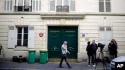 A Tuesday, Oct. 3, 2017 file photo showing the entrance of an apartment building where police found an explosive device. Three men have been handed preliminary terror-linked charges in the failed attack at a residential building in an upscale Paris neighborhood with gas canisters that failed to ignite. A judicial official said on Saturday, Oct. 7, 2017 that the three were placed under formal investigation late Friday in the mysterious attack attempt.