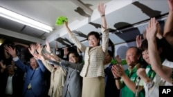 Former defense minister Yuriko Koike, center, celebrates her election as Tokyo governor with supporters.