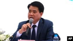 Ông Nguyễn Đức Chung trong một buổi họp báo khi còn tại chức.