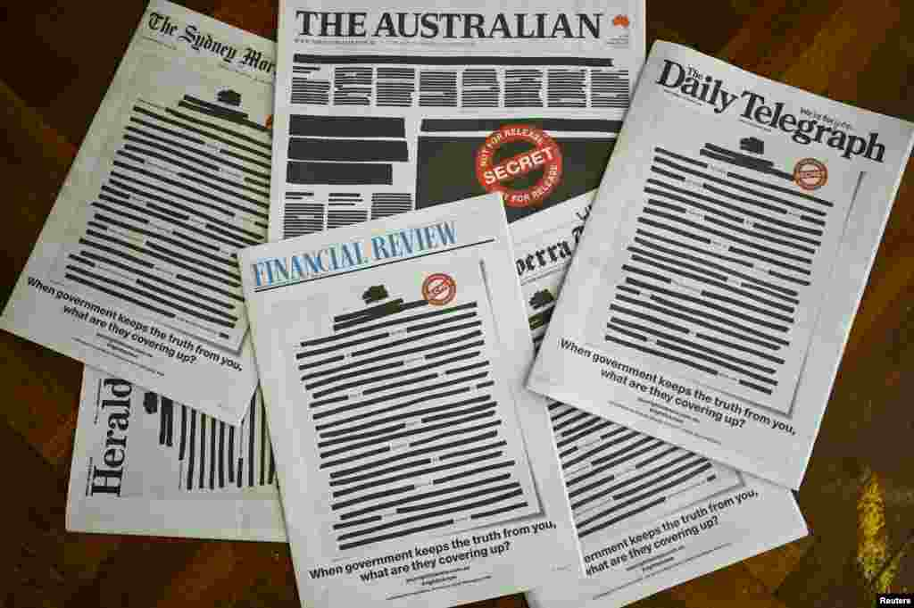 "Australian newspapers show a 'Your right to know"" campaign, in Canberra. Australia's biggest newspapers ran front pages made up to appear heavily redacted to protest against recent legislation that restricts press freedoms. (AAP Image/Lukas Coch)"