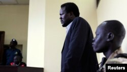 FILE - South Sudanese politician Ezekiel Gatkuoth (C) is seen standing in a courtroom in Juba, March 11, 2014.