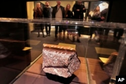 A fragment of a memorial fountain, that was constructed after Feb. 26, 1993 truck bomb attack at the World Trade Center and was destroyed on Sept. 11, 2001, is displayed at the National September 11 Museum, in New York, Feb. 23, 2018.