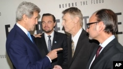 "FILE- U.S. Secretary of State John Kerry (from left) Leonardo Dicaprio, Piers Sellers and Fisher Stevens attend the premiere of National Geographic Channel's ""Before The Flood,"" at the United Nations headquarters, Oct. 20, 2016. Sellers, a climate scientist and former astronaut died Dec. 23. He was 61."