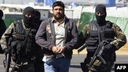 FILE - Alleged drug dealer Alfredo Beltran Leyva (C) is showed to the media by members of the Mexican Army in Mexico City, Jan. 21, 2008, after being captured in Culiacan, in the northwestern state of Sinaloa, along with three other members of his gang.
