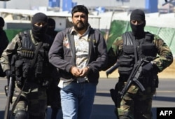 FILE - Alleged drugdealer Alfredo Beltran Leyva is showed to the media by members of the Mexican Army in Mexico City, on January 21, 2008, after being captured in Culiacan, in the northwestern state of Sinaloa, along with three other members of his gang.