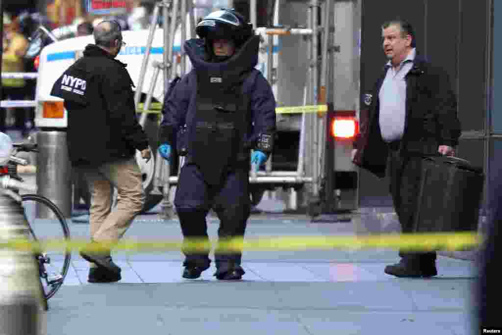 A member of the New York Police Department bomb squad is seen outside the Time Warner Center in New York City after a suspicious package was found inside the offices where CNN has studios.