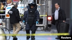 A member of the New York Police Department bomb squad is pictured outside the Time Warner Center in the Manhattan borough of New York City after a suspicious package was found inside the CNN Headquarters in New York, Oct. 24, 2018.
