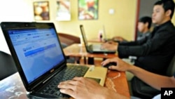 Cambodians using Internet at a coffee shop, in Phnom Penh.