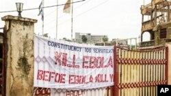 """2014年9月14日塞拉利昂利昂埃博拉宣传活动: """"埃博拉杀死你之前杀死埃博拉。"""""""