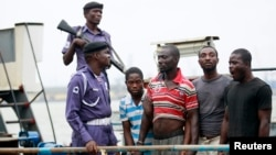 Suspected pirates are paraded aboard a naval ship after their arrest by the Nigerian Navy at a defense jetty in Lagos, August 20, 2013.