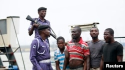 FILE - Suspected pirates are paraded aboard a naval ship after their arrest by the Nigerian Navy in Lagos August 20, 2013.