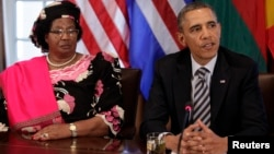 U.S. President Barack Obama (R) talks to the media next to President Joyce Banda of Malawi after his meeting with African leaders at the White House in Washington, March 28, 2013
