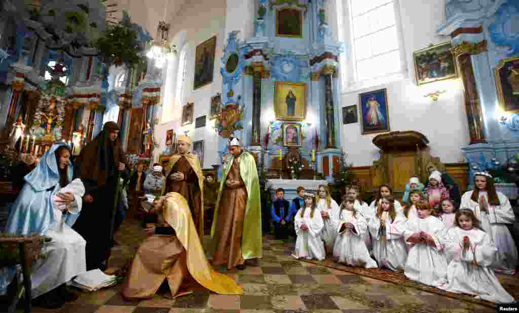 Belarusian children perform in a Catholic church in the town of Dyatlovo, Belarus, Dec. 25, 2017.