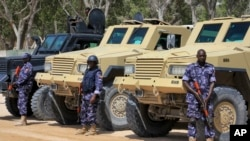 FILE - African Union (AU) soldiers stand with their armored vehicles near a checkpoint in Mogadishu, Somalia, Feb. 7, 2017.