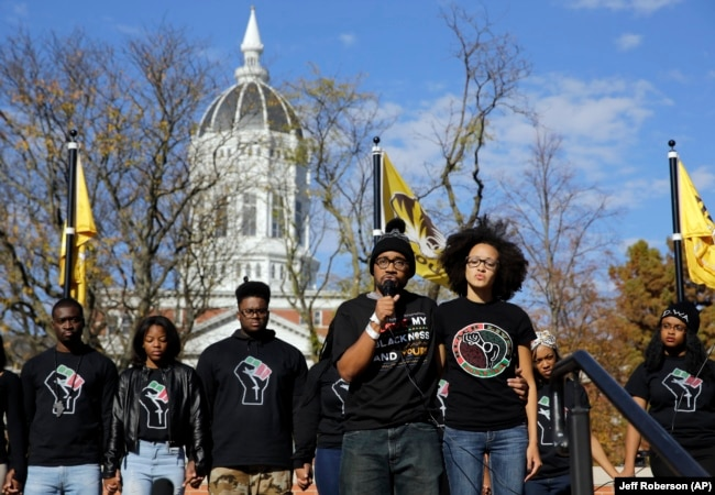 In this 2015 photo, graduate student and member of a black student group Jonathan Butler, center, speaks to a crowd during a demonstration at the University of Missouri.
