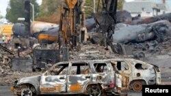 L'enquête se poursuit à Lac Megantic, au Québec, pour déterminer les circonstances de l'explosion qui a ravagé la ville