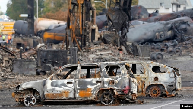 Burned cars are seen near the site of the oil tanker explosions in Lac Megantic, Quebec, July 9, 2013.