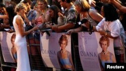 "Cast member Naomi Watts of Australia, who plays the title role, signs autographs before the world premiere of ""Diana"" at Leicester Square in London, Sept. 5, 2013."