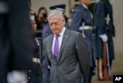 FILE - Then-Defense Secretary Jim Mattis waits for Chinese Minister of Defense General Wei Fenghe to begin an arrival ceremony at the Pentagon, Nov. 9, 2018.