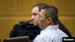 Johnathan Doody listens as he is found guilty of the 1991 execution-style murders of nine people, including six monks, at a Buddhist temple near Phoenix, January 23, 2014