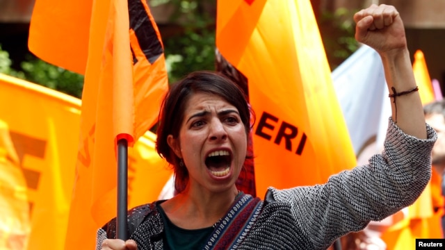 FILE - A protester shouts slogans against Turkey's Prime Minister Recep Tayyip Erdogan and his government's policy on Syria, during a demonstration in Ankara, May 18, 2013.