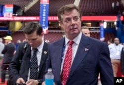 FILE - Trump campaign chairman Paul Manafort walks around the convention floor before the opening session of the Republican National Convention in Cleveland.