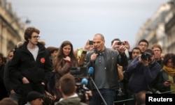 """Former Greek Finance Minister Yanis Varoufakis speaks in front of supporters of social media-driven movement """"Nuit Debout"""" (Up All Night), during their daily gathering on the Place de la Republique in Paris, France, against a French labour law proposal, April 16, 2016."""