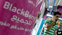 A sign advertising the BlackBerry mobile phone for all is seen at a shopping mall in Dubai (File)